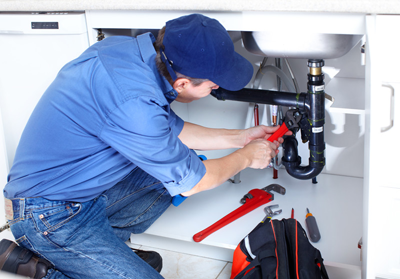 Plumber in North Miami Beach installs a J trap